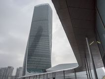 Snowing in Citylife, Milan. Milan, Lombardy, Italy: snow in late winter March at Citylife. the Hadid tower, or Generali tower Royalty Free Stock Photography