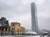 Snowing in Citylife, Milan. Milan, Lombardy, Italy: snow in late winter March at Citylife. the Isozaki tower, or Allianz tower Stock Image