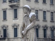 Snowing in Citylife, Milan. Milan, Lombardy, Italy: snow in late winter March at Citylife, a statue of the monumental fountain Royalty Free Stock Photos