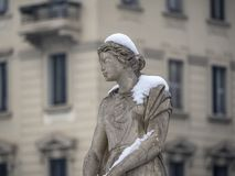 Snowing in Citylife, Milan. Milan, Lombardy, Italy: snow in late winter March at Citylife, a statue of the monumental fountain Royalty Free Stock Photography