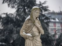 Snowing in Citylife, Milan. Milan, Lombardy, Italy: snow in late winter March at Citylife, a statue of the monumental fountain Royalty Free Stock Images
