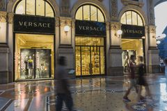 Milan Luxuous shopping mall. Night shot of the hall of the landmark arcade or covered mall, Galleria Vittorio Emanuele II in Milan, Italy . Expensive Ship with Royalty Free Stock Photography
