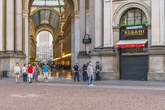 Milan Luxuous shopping mall. Sunny day shot of the hall of the landmark arcade or covered mall, Galleria Vittorio Emanuele II in Milan, Italy Stock Photography