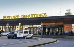 Airport bus at Milan, Italy`s Terminal 2 departure terminal, hub of budget airliner, Easyjet, servicing short-haul. Milan Malpensa, Italy - November 21st, 2017 Royalty Free Stock Image