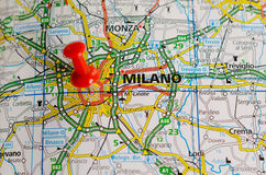 Milan on map. Close up shot of Milan Italy  on a map with red push pin Royalty Free Stock Image