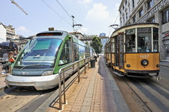 Milan Orange Cable Car and Modern Street car Royalty Free Stock Photography