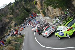 Milan-Sanremo Cycle Race 2008. Some cars assistance in the famous and international cycle race Milano-Sanremo 99° edition during the slope of Capo Berta near Royalty Free Stock Photos