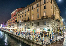 MILAN - SEPTEMBER 25, 2015: Tourists enjoy Navigli at night. Mil Royalty Free Stock Images