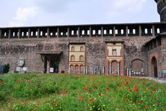 Milan Sforza Castle medieval fortifications, flowering internal garden and ancient brick wall background. Milan Sforza Castle medieval fortifications with stock images