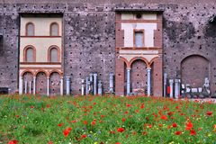 Milan Sforza Castle medieval fortifications, flowering internal garden and ancient brick wall background. Milan Sforza Castle medieval fortifications with royalty free stock image