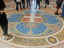 Galleria Vittorio Emanuele II of Milan: octagon Sabaudo coat of arms. Milan shopping gallery, connects Piazza Duomo to Piazza della Scala. With elegant shops and Stock Image