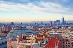 "Milan Skyline. View of Milan from the rooftoop of  ""Duomo di Milano"". Statues of  Duomo of Milan, Galleria Vittorio Emanuele II and skycrapert of Porta Nouva Stock Photos"