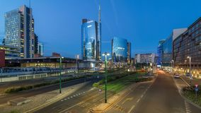 Milan skyline with modern skyscrapers in Porta Nuova business district day to night timelapse in Milan, Italy, after stock video footage