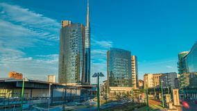 Milan skyline with modern skyscrapers in Porta Nuova business district timelapse in Milan, Italy, at sunset. stock video footage