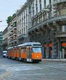 Milan street with orange tram Royalty Free Stock Photo