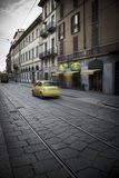 Milan street scene with motion blur on Italian car Stock Photo