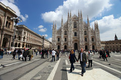 Milan: tourists visit Piazza Duomo Royalty Free Stock Image