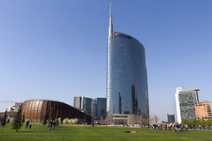 Milan - The UniCredit skyscraper, reflections in a spring day in Porta Nuova District Park, . Lombardy Italy. Milan, Italy - March 31, 2019. People enjoy in stock images