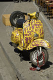 Milan wine shop Vespa pick-up for delivery of the wine at home Royalty Free Stock Photo