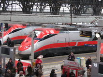 Milano centrale railway station with Frecciarossa trains. MILAN, ITALY - CIRCA JANUARY 2014: Milano Centrale, Main railway station in Milan with highspeed Royalty Free Stock Photography