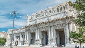 Milano Centrale timelapse in Piazza Duca d`Aosta is the main railway station of the city of Milan in Italy. Blue cloudy sky at summer day stock video footage