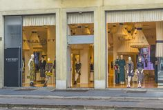 Milano city centre street view. Expensive shop with clothes and suits on the street in Milano city , Italy , Europe Royalty Free Stock Photos
