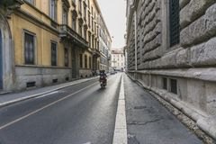 Milano city centre street view. With people and cars  . Italy , Europe. Evening time Stock Images