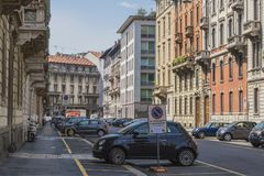 Milano city centre street view. With people and cars   . Italy , Europe. Expensive shop with clothes and suits Royalty Free Stock Photo