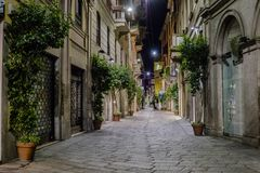 Milano city centre street view. With shops   . Italy , Europe. Expensive shop with clothes and suits. Night photography Royalty Free Stock Image