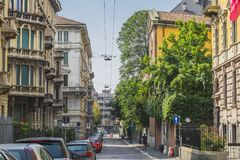 Milano city centre street view. With people and cars  . Italy , Europe Stock Photos