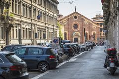Milano city centre street view. With people and cars  . Italy , Europe. And building with Leonardo da Vinci museum in background Royalty Free Stock Photo