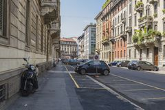 Milano city centre street view. With people and cars   . Italy , Europe. Expensive shop with clothes and suits Royalty Free Stock Images