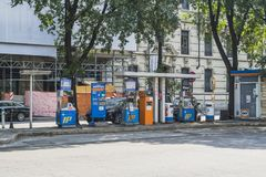 Milano city centre street view. With people and cars   . Italy , Europe. Filling station in the city Stock Images