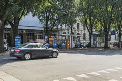 Milano city centre street view. With people and cars   . Italy , Europe. Filling station in the city Royalty Free Stock Photos
