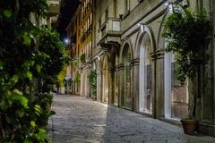 Milano city centre street view. With shops   . Italy , Europe. Expensive shop with clothes and suits. Night photography Stock Photos