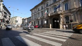 Milano, Corso Magenta , Palazzo Litta, September 5, 2017 - Superintendence archeology beautiful arts and landscape - a cyclist cr. Osses an Esselunga truck stock video