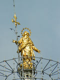 Milano Dome ( Duomo ) main golden Statue on top of the highest tower. This is a photo of the famous dome in Milano, Italy., representing the main golden statue Royalty Free Stock Photography