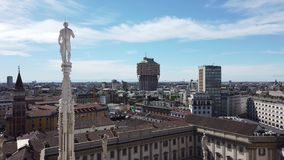 Milano, Italy. Panorama of the city and the Velasca skyscraper from the roof terrace of the cathedral. The white marble spiers of the Duomo stock footage