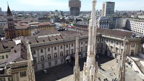 Milano, Italy. Panorama of the city and the Velasca skyscraper from the roof terrace of the cathedral. The white marble spiers of the Duomo stock video footage