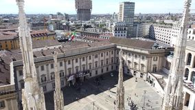 Milano, Italy. Panorama of the city and the Velasca skyscraper from the roof terrace of the cathedral. The white marble spires. Of the Duomo stock video footage