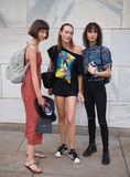 MILANO, Italy: September 21, 2018: Fashionable people in street style outfit on Arengario stairs royalty free stock photo