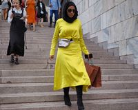 MILANO, Italy: September 21, 2018: Fashionable woman in street style outfit on Arengario stairs stock photos
