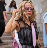 MILANO, Italy: September 21, 2018: Fashionable woman in street style outfit on Arengario stairs stock photo