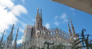 Milano, Italy. The spires of white marble that adorn the entire cathedral. The Duomo is the most famous landmark in Milan. Amazing view stock photo