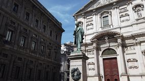 Milano, Italy. The statue of Alessandro Manzoni and the church of San Fedele. In the town center stock video