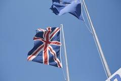 English and European flags. Milano Marittima, Italy - July 31, 2017: English and European flags in a beach club royalty free stock images