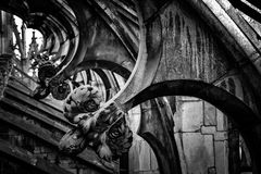 The Duomo Cathedral of Milan rooftop gothic architecture. Detail of a marble architecture of the rooftop in black and white royalty free stock image