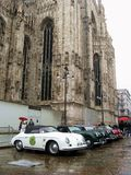 Milano Sanremo. In frot of Palazzo Reale, in the center of Milano (Italy), a group of classic cars joining for the start of the Milano-Sanremo historical race Royalty Free Stock Image
