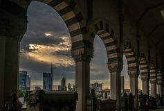 Milano skyline view in a cloudy day with epic sky. From the monumental cemetery stock photography