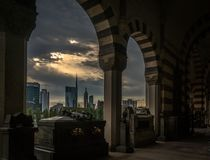 Milano skyline view in a cloudy day with epic sky. From the monumental cemetery royalty free stock image